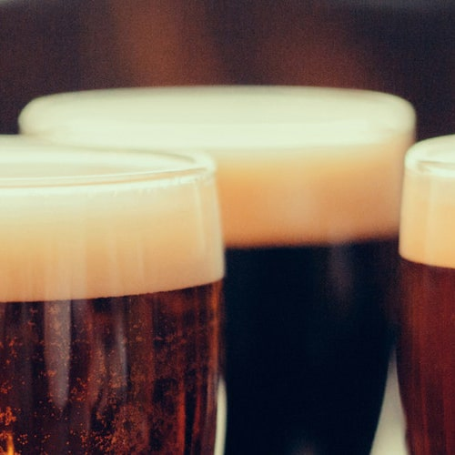 It's all beer. Why does the dark beer bubble go down?
